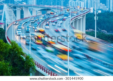 traffic stream closeup on the curve bridge - stock photo
