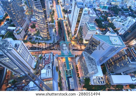 Traffic though modern city nightscape - stock photo