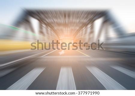 traffic through bridge with blur trail - stock photo