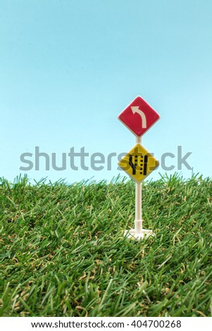 Traffic Toy Sign on Green Grass.