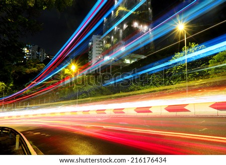Traffic trail in city - stock photo