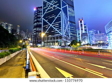 traffic with blur light through city at night - stock photo