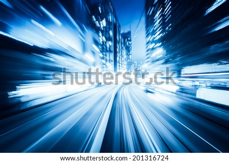 traffic with blur light through city at night - stock photo