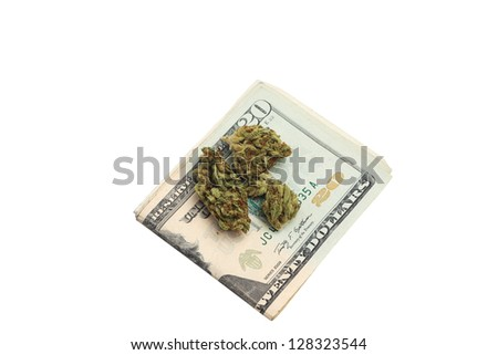 Trafficking/Marijuana buds atop US currency against white background