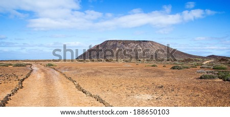 Trail and volcano La Caldera on the small island of Los Lobos, near Fuerteventura, in the Canary Islands, Spain.