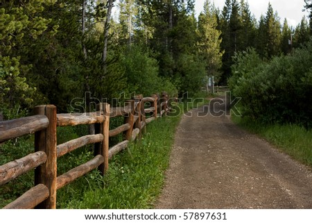 Trail by Henry's Fork of Snake River in Island Park Idaho near West Yellowstone National Park - stock photo