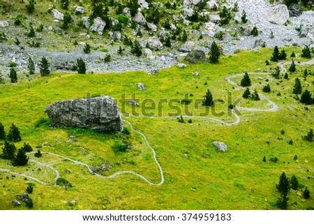 trail in the Alps, beautiful mountain landscape with a winding path