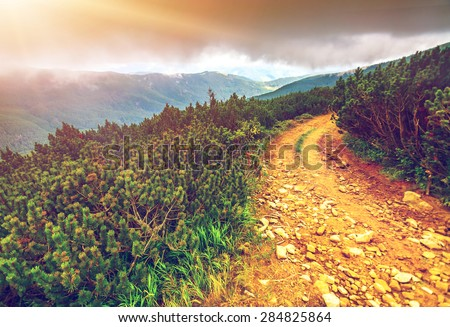 Trail leading through the mountain valley. Beauty world. - stock photo