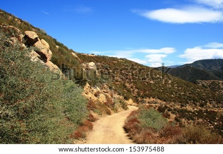 Trail leading through the mountains in the desert, California - stock photo