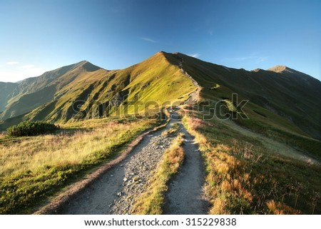 Trail leading to the summit in the Tatra Mountains in early September. - stock photo