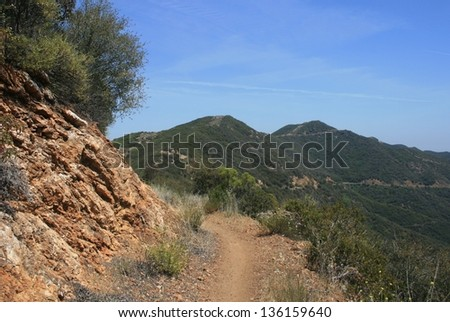 Trail leading up the side of a mountain, Malibu, California - stock photo