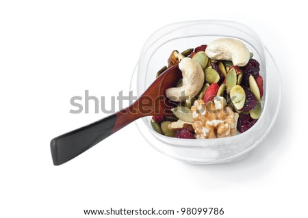 Trail mix container with spoon on white