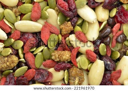 Trail mix with pumpkin seeds, dried cranberries, almonds, goji berries - stock photo