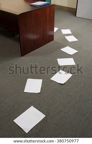 Trail of paper in office