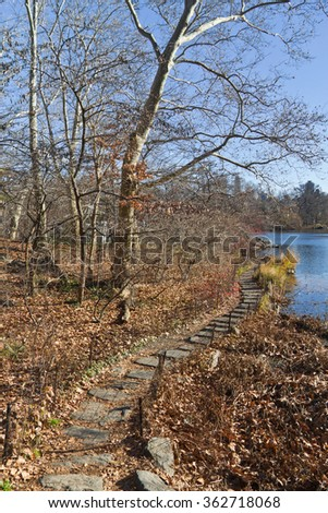 Trail on the lake at Central Park with trees without foliage. - stock photo