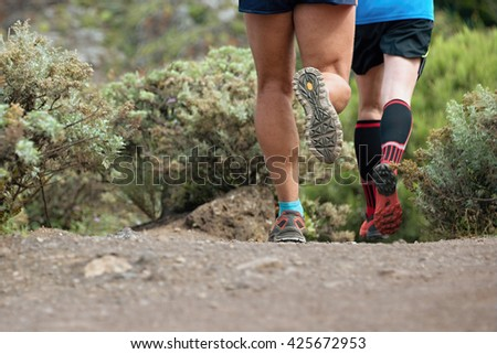 Trail running cross-country runners in race