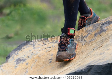 Trail running man on mountain path exercising