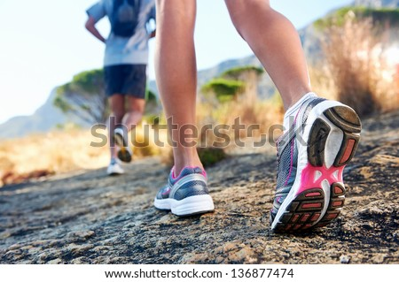 trail running marathon fitness feet on rock fitness and healthy lifestyle