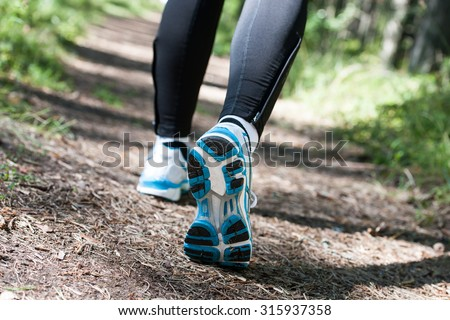 Trail running or trail walking woman