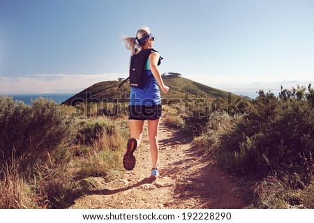 Trail running woman workout for healthy marathon fitness - stock photo