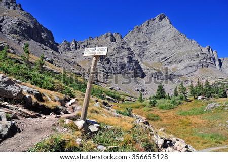 Trail Sign pointing to Colorado 14er, Crestone Needle, Sangre de Cristo Range, Rocky Mountains, USA - stock photo