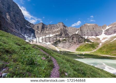 Trail to Cracker lake in Glacier national park - stock photo