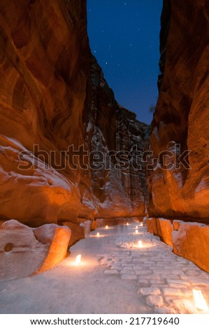 Trail to the Treasury (Khasneh) in Petra, Jordan at night - one of most beautiful sites in middle east - stock photo