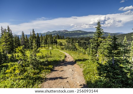 Trail view in Mountains - stock photo
