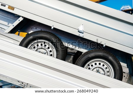 Trailer transportation on a trailer from the production factory - stock photo