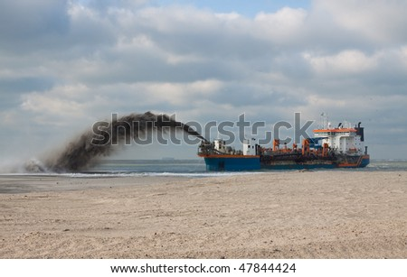 "Trailing Suction Hopper dredger ""Utrecht"" Rain-bowing sand on the beach"