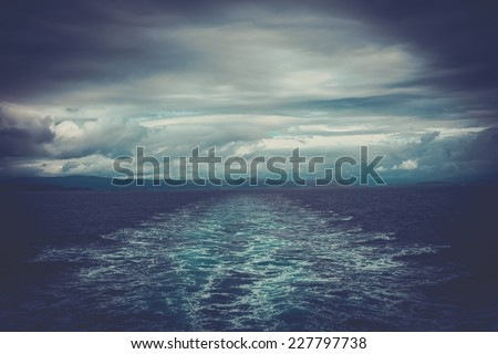 Trails behind ship in a water  - stock photo