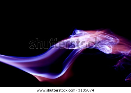 Trails of red, white and blue incense smoke. - stock photo