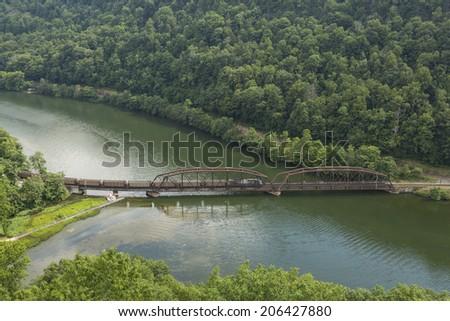 Train Along The New River - stock photo