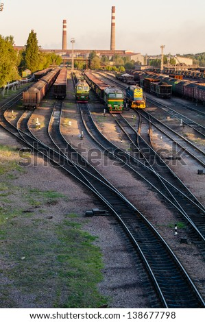 train and the train depot in the evening sunset - stock photo