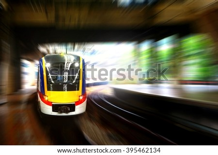 Train approaching station platform with blur motion - stock photo