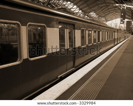 Train at Southern Cross Station, Melbourne - Sepia - stock photo