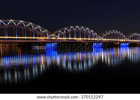 Train bridge over the Daugava river in Riga, Latvia.