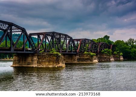 Train bridge over the Susquehanna River, seen from Shikellamy State Park in Sunbury, Pennsylvania. - stock photo