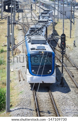 Train by the railway station  - stock photo