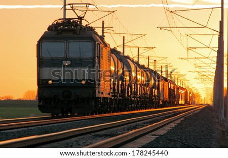 Train cargo in railroad at a sunset - stock photo