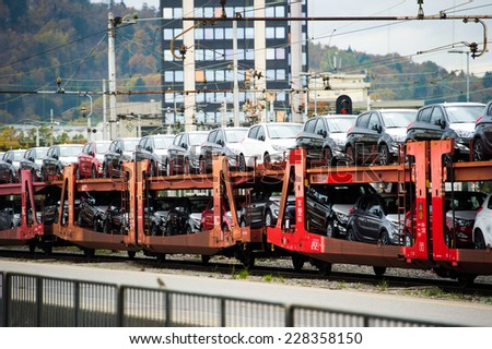Train carrying cars. - stock photo