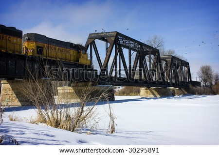 Train crossing bridge, Snake River, Blackfoot Idaho - stock photo