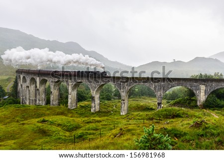 Train crossing the Glenfinnan Viaduct, Scotland, UK