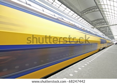 Train departure from Central Station in Amsterdam the Neherlands - stock photo