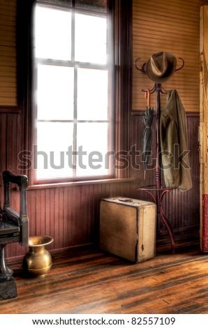 Train Depot - coat rack, window, spittoon - stock photo