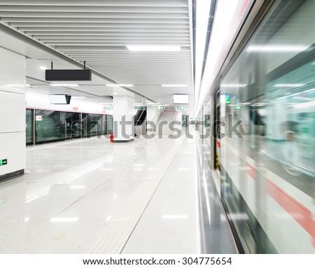 train fast moving at subway station - stock photo