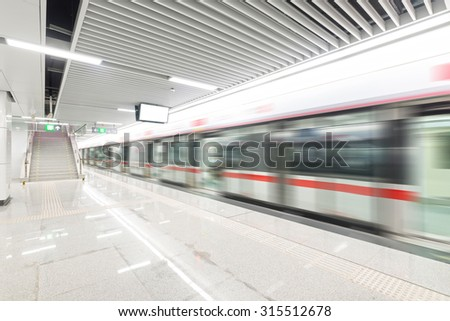 train fast moving at subway station - stock photo