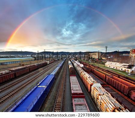 Train Freight transportation with rainbow - Cargo transit - stock photo