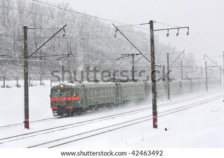 Train, going through a blizzard. Snow falls - stock photo