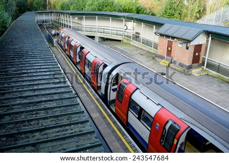 Train in High Barnet station, London which is last stop on the  Northern Line as part of London underground network - stock photo